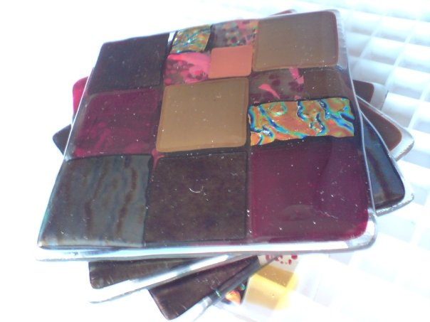 Stack of Four Glass Coasters